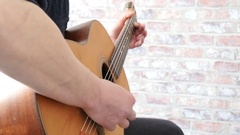 Man's hands playing acoustic guitar, close up Stock Footage
