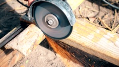 Cutting old rusted iron pipe with an angle grinder outdoors Stock Footage