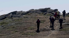 Group of tourists who go on a trail through the rocks  Stock Footage