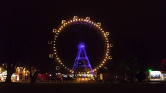 Famous Prater Wiener Riesenrad Ferris wheel in the evening. Popular touristic Stock Footage
