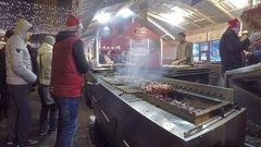 The cooks prepare traditional Caucasian shashlikat Central Christmas Market Stock Footage