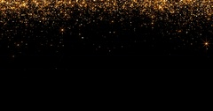 Waterfalls of golden glitter sparkle bubbles particles on black background Stock Footage