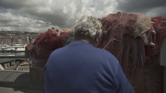 Fisherman works alone italy clouds city slow motion Stock Footage
