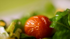 Tomato put hands in the salad. Macro Stock Footage