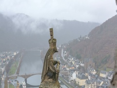 A gargoyle like statue looking out over a German valley with a subtle zoom Stock Footage