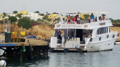 Cruise Boat with Passengers Approaches to the Pier in the Red Sea Stock Footage