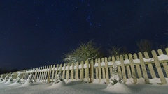 Night sky stars time lapse, wooden fence foreground in house backyard Stock Footage