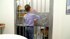 Young boy opening of the vault door in bank Stock Footage