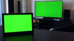 A tablet on a desk in a horizontal position - a TV - green screen Stock Footage