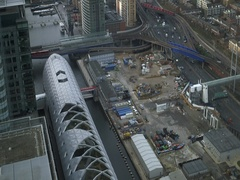 Aerial view on Cross rail station Canary Wharf and city of London Stock Footage