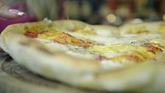 Closeup of Female Hand Takes a Piece of Hot Pizza in a Italian Restaurant Stock Footage