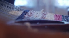 Detail from an old loom a woman working and make a a door mat 47 Stock Footage