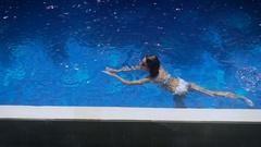 Hotel area. Pool. the island of Bali. The girl in a white bathing suit and dark Stock Footage