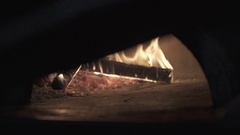 Retro oven fire in slow motion cooking pizza Stock Footage