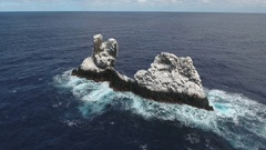 Aerial shot of ocean waves crashing spiky rock, cliff, reef - Roca Partida Stock Footage