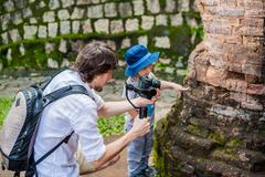 Man videographer and his son shoots video in the electronic stabilizer, ste.. Stock Photos