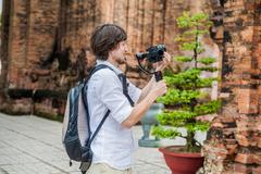 Man videographer shoots video in the electronic stabilizer, steadycam To sh.. Stock Photos