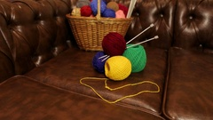 Basket of yarn for knitting on the couch. Stock Footage