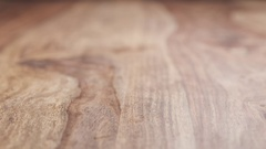 Clementine segments falling on wood table in slow motion Stock Footage