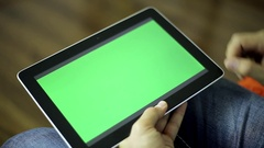 Male hand operated tablet computer with a green screen for your content. Stock Footage