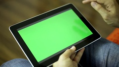 Man with the tablet.  A man holding a tablet computer with a green screen. Stock Footage