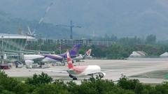 Airplane of Ikar Airlines drives along airport terminal Stock Footage