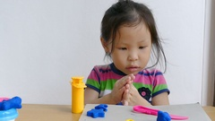 Little girl play with dough Stock Footage