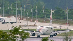 Aircraft of Malaysia Airlines turn from runway to taxiway Stock Footage