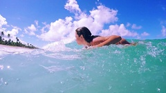 Surf Girl Paddling To Catch Wave In A Beautiful Sunny Day In Slow Motion Stock Footage
