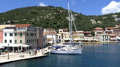 General view of the port of the island Gaios Paxo with old houses and Stock Footage