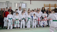 Martial arts competition attended by a group of children under the clo Stock Footage