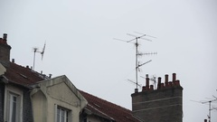 Pan on chimneys and television antennas Stock Footage