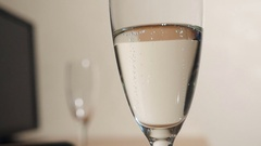 The bubbles of champagne in glass Stock Footage