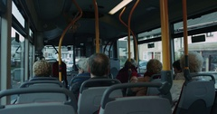 A bus with few people going through the city,view from bus. 4k Stock Footage