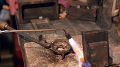Goldsmith preparing tools for melting gold Stock Footage