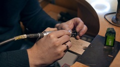 Jeweler at work in jewelery workshop Stock Footage