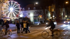 Groups of people and cyclists passing a pedestrian crossing on green t Stock Footage