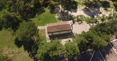 Drone shot above a small church in Italy at summer Stock Footage