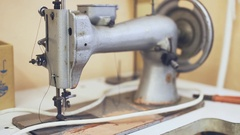 Old sewing machine. clothing production Stock Footage