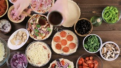 Preparing individual pizzas from pizza bar. Stock Footage
