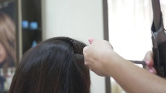Stylist uses curling hair Stock Footage