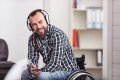 Smiling handicapped man excited about new track Stock Photos