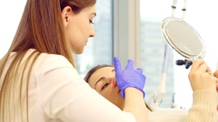 Beauty parlor, the doctor prepares the patient for the procedure Stock Footage
