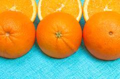 Orange and lemon citrus fruit pattern on light blue background Stock Photos