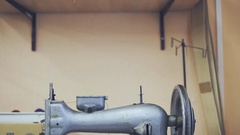 Old sewing machine. manufacture of wearing apparel Stock Footage