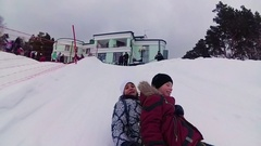 Happy family rides and smiling snowtube on snowy roads Stock Footage