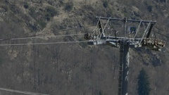 Installation of the cable car that leads tourists to a deep valley bel Stock Footage