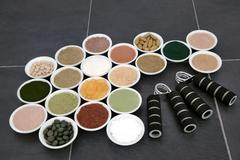 Body Building Supplements and Hand Grippers Stock Photos