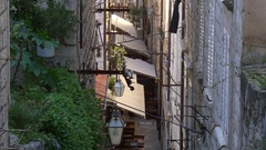 Narrow street land with bars, cafes and restaurants in Dubrovnik, Croatia Stock Footage