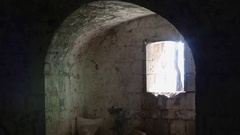 Sun shining through old dungeon window Stock Footage